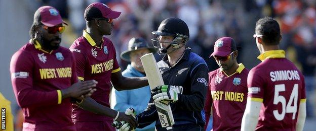 Martin Guptill shakes hands with West Indies captain Jason Holder