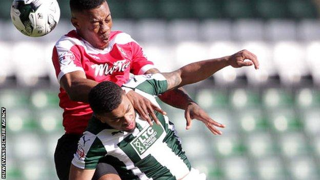 Ryan Jackson of Newport County gets above Tareiq Holmes-Dennis of Plymouth Argyle