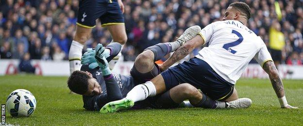 Tottenham keeper Hugo Lloris was carried off on a stretcher after colliding with team-mate Kyle Walker