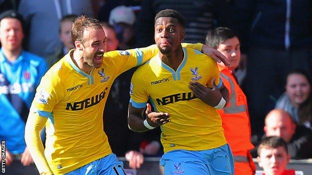 Wilfried Zaha celebrates with Glenn Murray