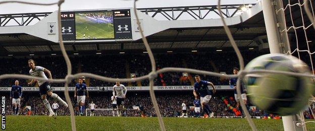 Tottenham striker Harry Kane scores a penalty against Leicester