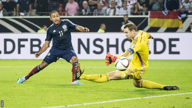 Ikechi Anya scores for Scotland against Germany in September