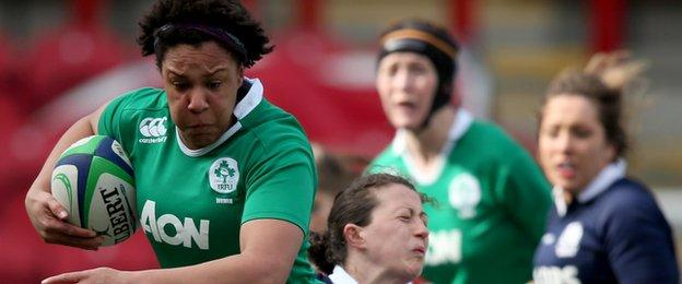 Ireland's Sophie Spence is tackled by Nuala Deans of Scotland during the match at Broadwood Stadium