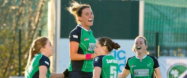 Nikki Evans leaps in celebration after putting Ireland ahead in the Belfield decider