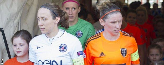 PSG captain Sabrina Delannoy and Glasgow City counterpart Leanne Ross lead their teams out