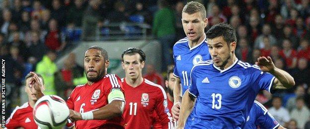 Ashley Williams (left) for Wales versus Bosnia