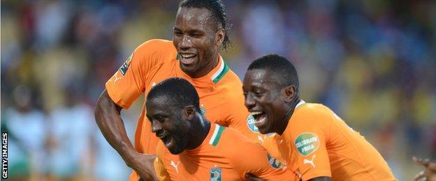 Didier Drogba, Yaya Toure and Max Gradel celebrate