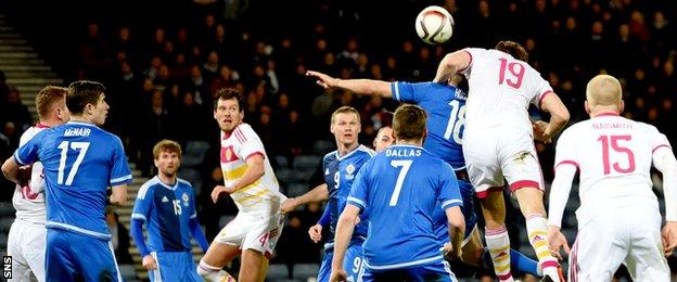 Christophe Berra (19) rises above the Northern Ireland defence to score the only goal of the game