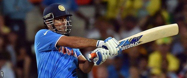 Mahendra Singh Dhoni plays a shot off Australia's Mitchell Johnson