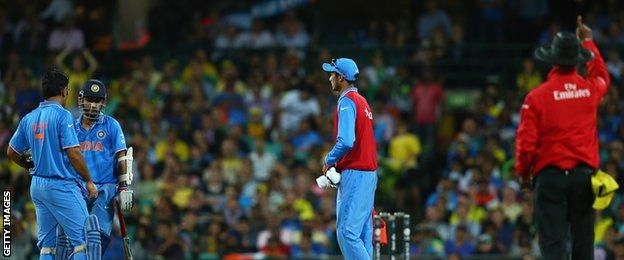 Ajinkya Rahane of India looks dejected as his is given out by Umpire Kumar Dharmasena after a DRS referral