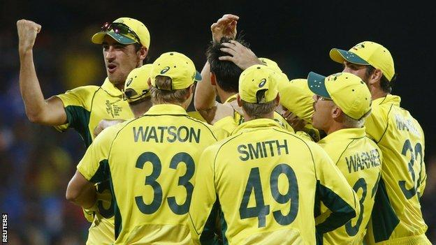 Mitchell Starc (L) celebrates with team mates