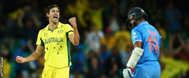 Mitchell Starc of Australia celebrates dismissing Umesh Yadav