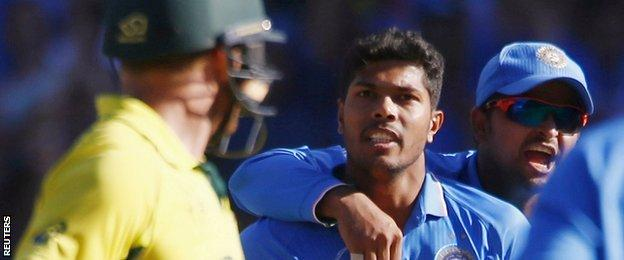 India bowler Umesh Yadav (centre) looks at Australian batsman Aaron Finch