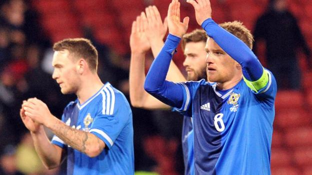 Northern Ireland players acknowledge their supporters after the 1-0 defeat b y Scotland at Hampden Park