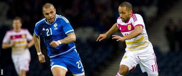 Ikechi Anya (right) takes on Kilmarnock and Northern Ireland striker Josh Magennis