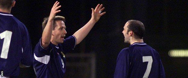 Billy Dodds (left) celebrates scoring in a 4-0 win over San Marino in 2001
