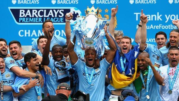 Manchester City with the Premier League trophy