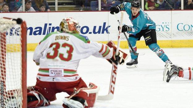 Devils netminder Ben Bowns awaits a shot from Belfast's Craig Peacock