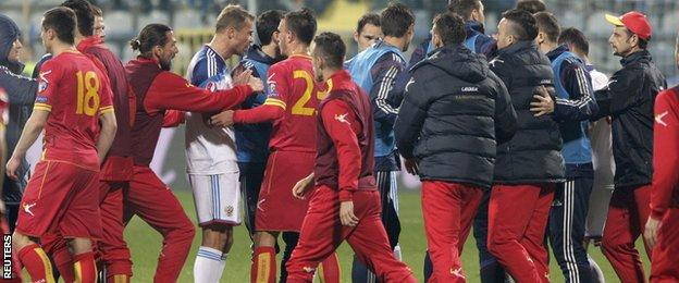 Montenegro and Russia players brawl during their Euro 2016 qualifier