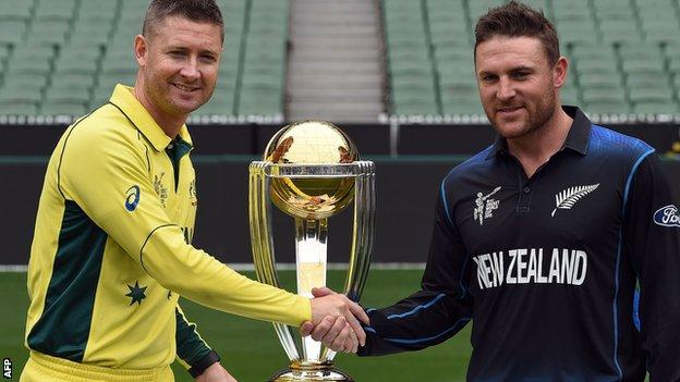 The two captains, Michael Clarke and Brendon McCullum, pose with the World Cup trophy