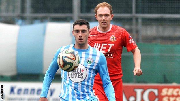 John McGuigan battles with Portadown's Ross Redman at Milltown