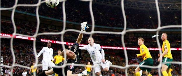Wayne Rooney scores England's opening goal against Lithuania