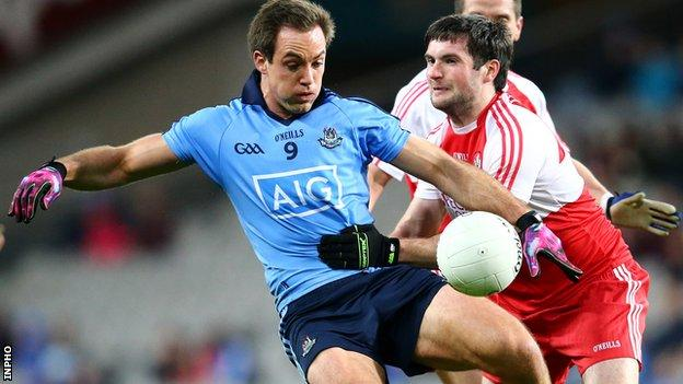 Dublin's Tomas Brady is challenged by Derry's Oisin Duffy