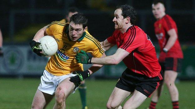 Padraic Harnan is challenged by Down's Conall McGovern at Pairc Esler