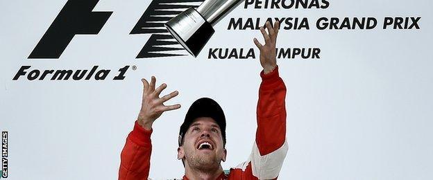 Sebastian Vettels throws trophy