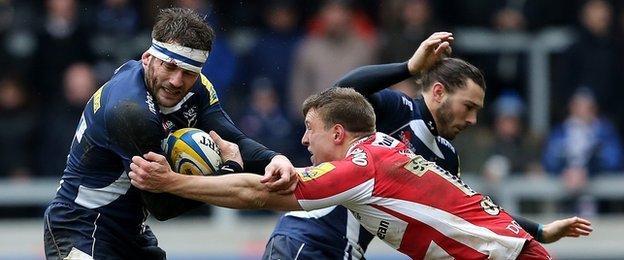 Sale's Mark Cueto is tackled by Gloucester's Brendan Macken
