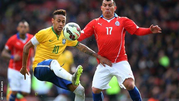 Chile's Gary Medel clashes with Brazil's Neymar at the Emirates Stadium