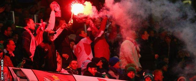 The match started with smoke floating across the Aviva Stadium pitch after Poland fans let off flares