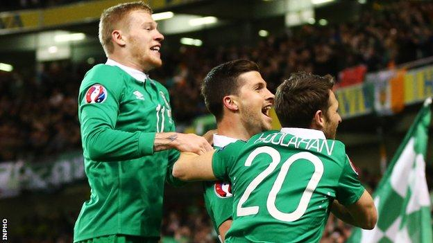 Shan Long celebrates with James McClean and Wes Hoolahan after scoring the Republic of Ireland's equaliser against Poland in Dublin