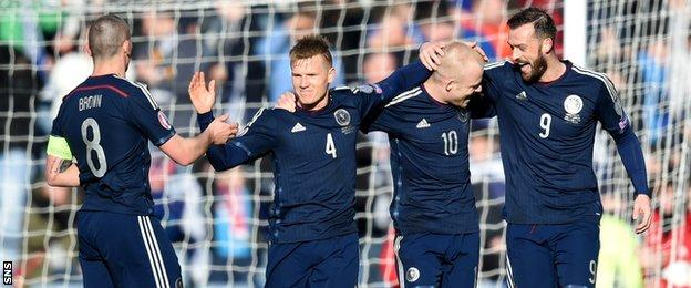 Scotland's Steven Naismith (2nd right) celebrates his goal with team-mates