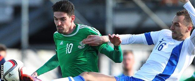 Northern Ireland's Kyle Lafferty in action against Sakari Mattila of Finland