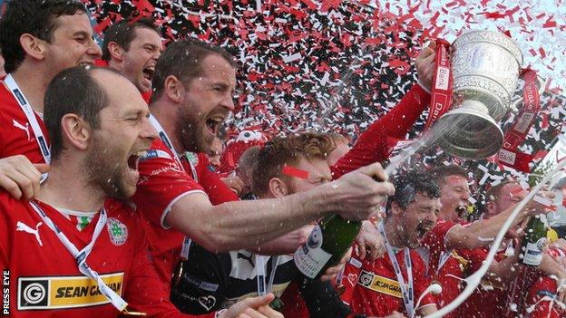 Cliftonville players celebrate winning the Irish Premiership title last year