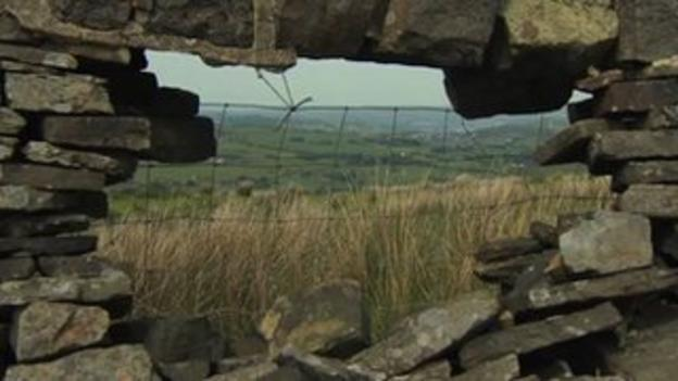 view of the Pennine Way through stone wall along trail