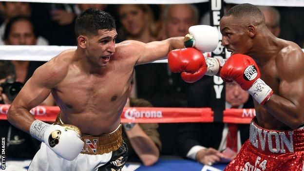 Amir Khan (left) in action against Devon Alexander