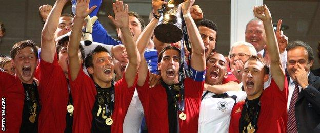 Mesut Ozil and Sami Khedira celebrate winning the 2009 Under-21s European Championship