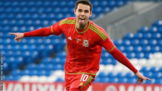 Tom O'Sullivan celebrates one of his first half goals for Wales under-21 against Bulgaria