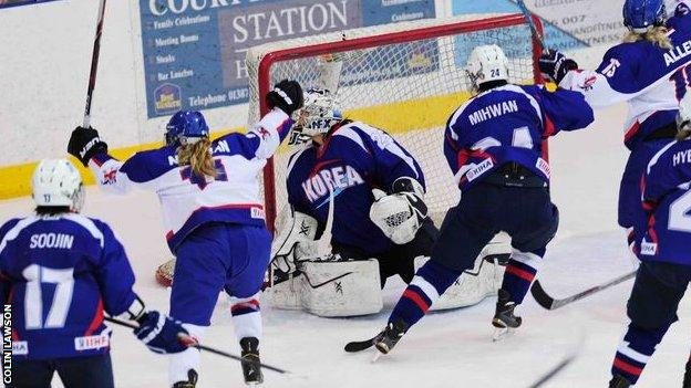 Great Britain's Chrissy Newman scores against Korea