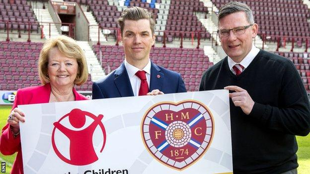 Ann Budge (left) and Craig Levein (right) join Save the Children's Neil Mathers to announce the new deal