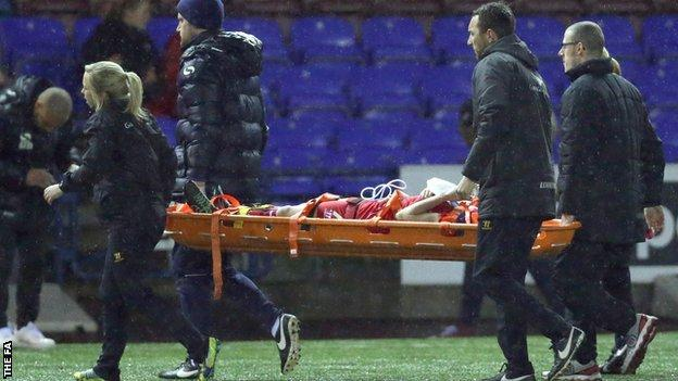 Kate Longhurst stretchered off the field for Liverpool