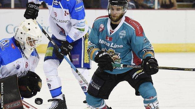 Darryl Lloyd of the Belfast Giants has a shot saved by Brian Stewart, netminder for the Coventry Blaze