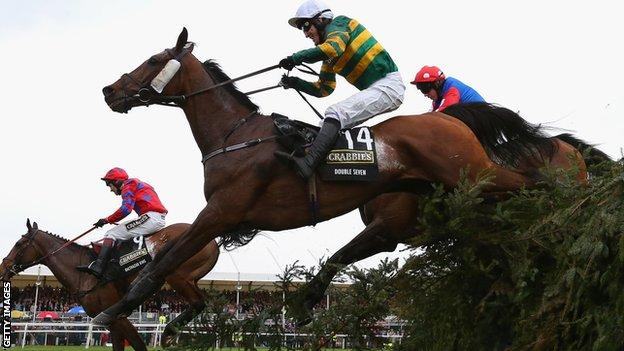 AP McCoy jumps the last fence in them 2014 Grand National
