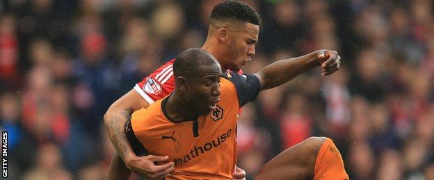 Nottingham Forest's Jamaal Lascelles and Wolves' Benik Afobe