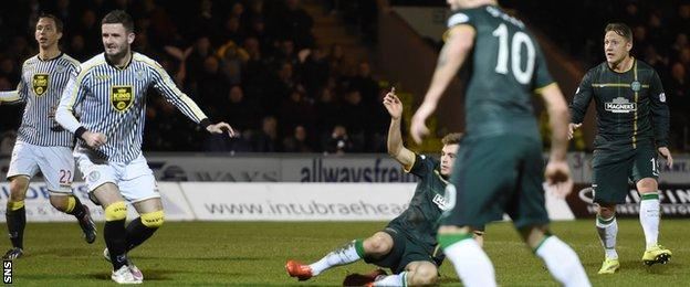 James Forrest (grounded) watches his shot hit the net to give Celtic the lead