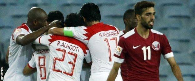 Bahrain celebrate scoring against Qatar at the Asian Cup