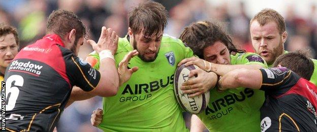 Josh Turnbull of Cardiff Blues is tackled by James Thomas, Cory Hill and James Benjamin of Newport Gwent Dragons
