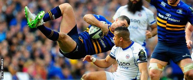 Anthony Watson takes out Rob Kearney in the air